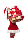 Sexy mrs claus santa holding heavy stack of christmas gifts Royalty Free Stock Images