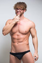 Sexy muscular male model wearing in glasses Royalty Free Stock Photo