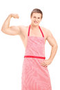 Sexy muscular man wearing a red apron isolated on white background Stock Images