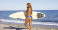 Sexy muscular young woman surfer with her board Royalty Free Stock Photo