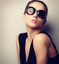 Sexy perfect female model posing in fashion sun glasses. Vintage Royalty Free Stock Photo