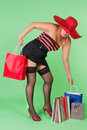 Sexy pin up shopping girl holding paper bags Royalty Free Stock Image
