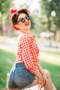 Sexy pinup girl outdoors, retro american fashion Royalty Free Stock Photo