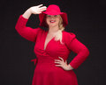 Sexy plus size woman in red hat with red lips. Royalty Free Stock Photo
