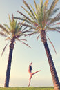 Sexy pretty girl in bikini jumping or flying under Royalty Free Stock Photo