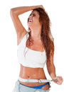 Sexy red hair woman in wet white t shirt Stock Photography
