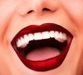 Sexy red lips glossy model with fashion makeup face part beautiful white teeth female laughing facial expression glamor concept Stock Photography