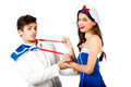 Sexy sailor woman seducing elegant young man Stock Images
