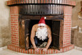 Sexy santa is in the chimney claus with funny expression Stock Photos