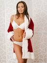 Sexy santa claus photo of a beautiful woman in her underwear posing with a jacket as a gift Royalty Free Stock Photography