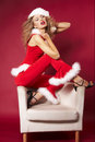 Sexy santa helper on red background Royalty Free Stock Images