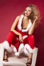 Sexy santa helper on red background Stock Photography