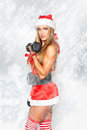 Sexy santa woman with barbell bodybuilder Stock Photography