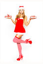Sexy santa woman holding gift packages blonde two christmas teeth smile Stock Photography