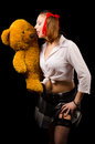 Sexy schoolgirl with teddy bear posing in studio her Royalty Free Stock Image