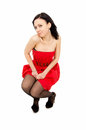 Sexy shapely girl posing in a dress red Royalty Free Stock Image