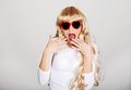 Sexy shocked blonde woman in sunglasses. Royalty Free Stock Photo