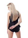 Sexy slim blonde posing back to camera isolated on white Royalty Free Stock Images