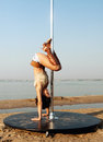 Sexy slim woman exercise pole dance outdoors Stock Photo
