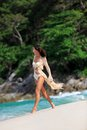 Sexy slim woman walking at beach a tropical in thailand Stock Photos