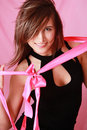 Sexy smiling girl with bow on a pink background Royalty Free Stock Photography