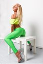 Sexy sporty woman blond in green leggings Royalty Free Stock Images