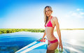 Sexy surfer girl posing with the surf board in the ocean, Bali Royalty Free Stock Photo