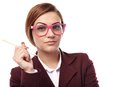 Sexy teacher holding a pen and wearing glasses closeup of an attractive young in the hand pink nerd having attitude isolated on Royalty Free Stock Image