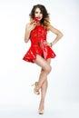 Sexy tempting dominatrix in vivid art costume with chili pepper female Stock Image