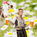 Sexy tiroler woman with a big glass of beer party creation made very or girl in traditional austrian or german oktoberfest clothes Stock Image