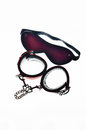 Sexy toys red leather handcuffs and bandage for eyes Royalty Free Stock Photos