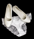 Sexy wedding lingerie isolated on the black bride underwear and shoes Stock Photo