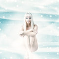 Sexy winter woman sitting on christmas background white hair a snow Stock Images