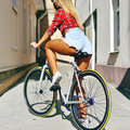 Sexy woman back on sport style fixed gear bicycle outdoor Royalty Free Stock Photo