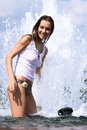 Sexy woman bathes in a city fountain young Stock Images