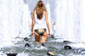 Sexy woman bathes in a city fountain young Royalty Free Stock Photos