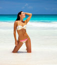 Sexy woman on the beach photo of sea side slim tanned model posing attractive wearing stylish colorful swimsuit summer Royalty Free Stock Images