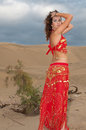 Sexy woman belly dancer arabian in desert dunes at the afternoon Stock Photography