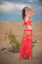 Sexy woman belly dancer arabian in desert dunes at the afternoon Stock Image
