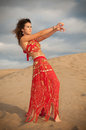 Sexy woman belly dancer arabian in desert dunes at the afternoon Stock Photo