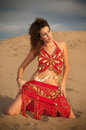Sexy woman belly dancer arabian in desert dunes at the afternoon Stock Photos
