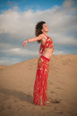 Sexy woman belly dancer arabian in desert dunes at the afternoon Royalty Free Stock Image