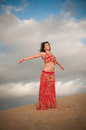Sexy woman belly dancer arabian in desert dunes at the afternoon Royalty Free Stock Photos