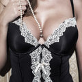 Sexy woman with big tits holding pearls sensuality Royalty Free Stock Photos