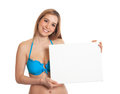 Sexy woman in bikini with blank signboard attractive young a on an isolated white background Royalty Free Stock Image