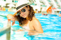 Sexy woman in bikini enjoying a hot summer day in private pool at tropical resort on the beach Royalty Free Stock Image