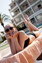 Sexy woman in bikini relax on sunlounger sunbathing Royalty Free Stock Photo