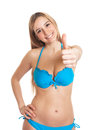 Sexy woman in bikini showing thumb up beautiful young on on an isolated white background Stock Photos