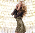 Sexy woman in black clothes beauty gold dress Royalty Free Stock Photos