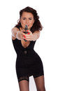 Sexy woman in black dress with a gun on white background Stock Photo